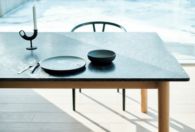 As Long As You Like dining table, by Jenkins & Uhnger, in Lundhs Blue stone.